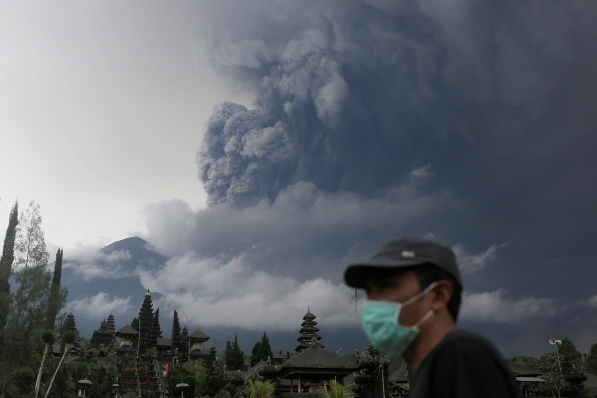 A volcano in Bali is on the verge of a major eruption, experts warn, as it blasts ash five miles high into the air.  • Mass evacuations ordered • Main airport closed  • Nearly 450 flights cancelled