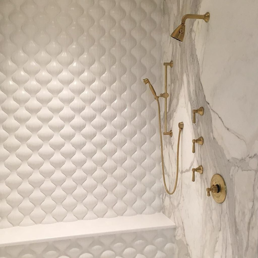 Walker zanger walkerzanger twitter our kaza concrete lantern tile brings sinuous texture to this stunning shower where its paired with calacata marble and brass fixtures dailygadgetfo Choice Image