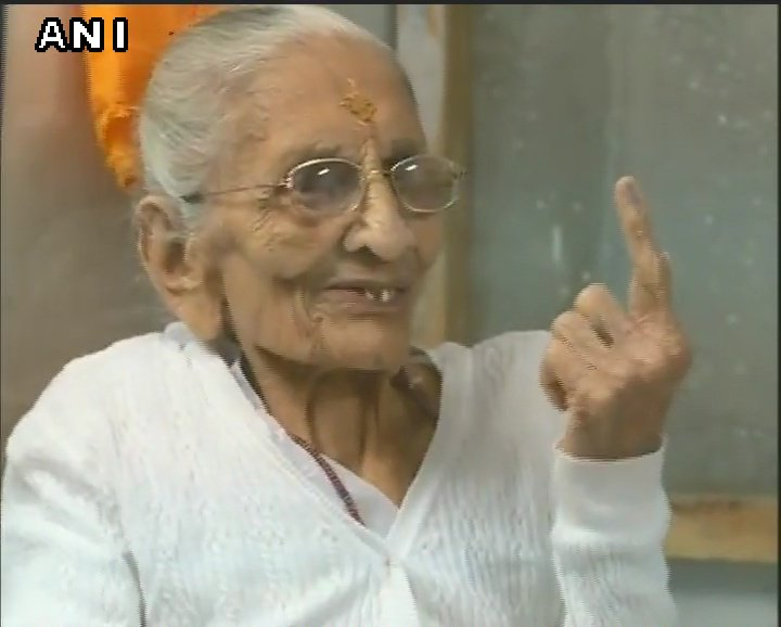 PM Modi's mother Heeraben cast her vote in a polling booth in Gandhinagar #GujaratElection2017