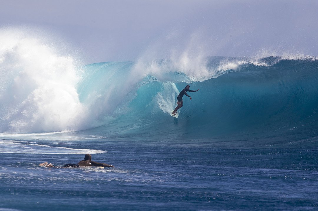 Sliding into shelter.  Tavarua Photo: Nick Liotta