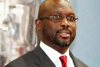 Former soccer star George Weah faces Vice-President Joseph Boakai as Liberia holds a delayed presidential run-off vote Dec 26, says election body
