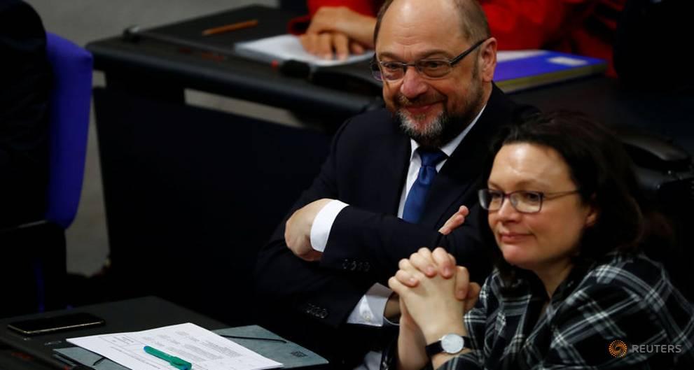 Merkel courts Germany's skittish SPD as...