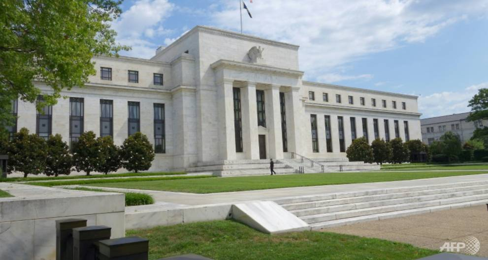 Fed raises interest rates, keeps policy...