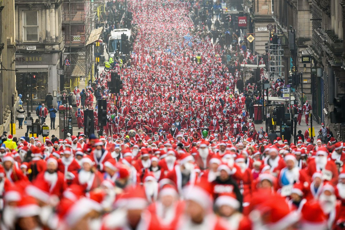 Red and white: Over 8000 runners of all ages took part in the annual #Santa Dash 5k in #Glasgow, #Scotland, raising £250,000 for charities on Sunday