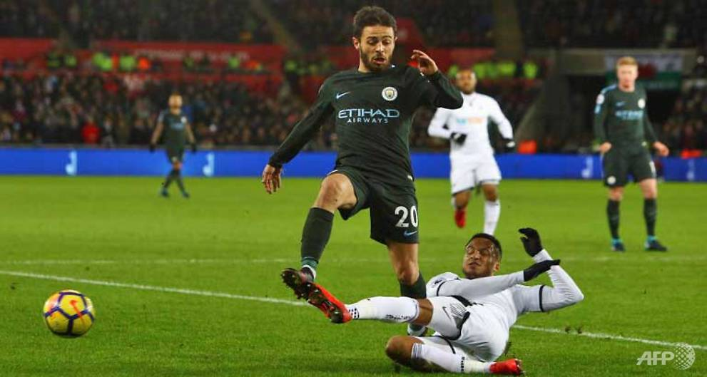 Football: Manchester City power to recor...