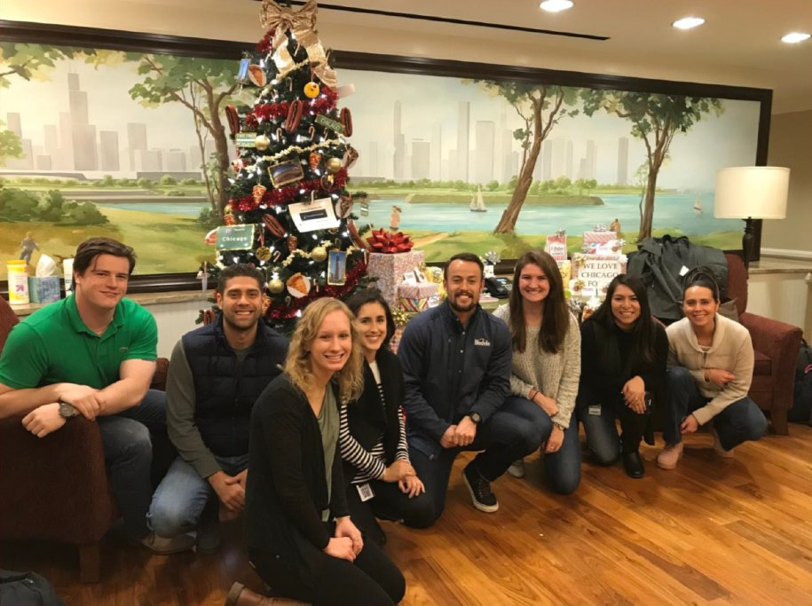 by decorating trees at ronald mcdonald house to support families who need a place to stay while their child is treated in the hospital