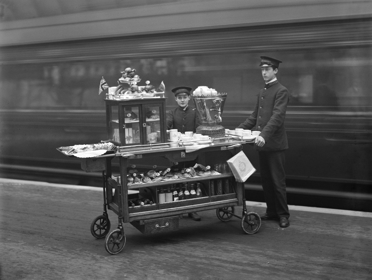 Love this photo of boys offering refreshments to travelers at London's Paddington Station, 1910.