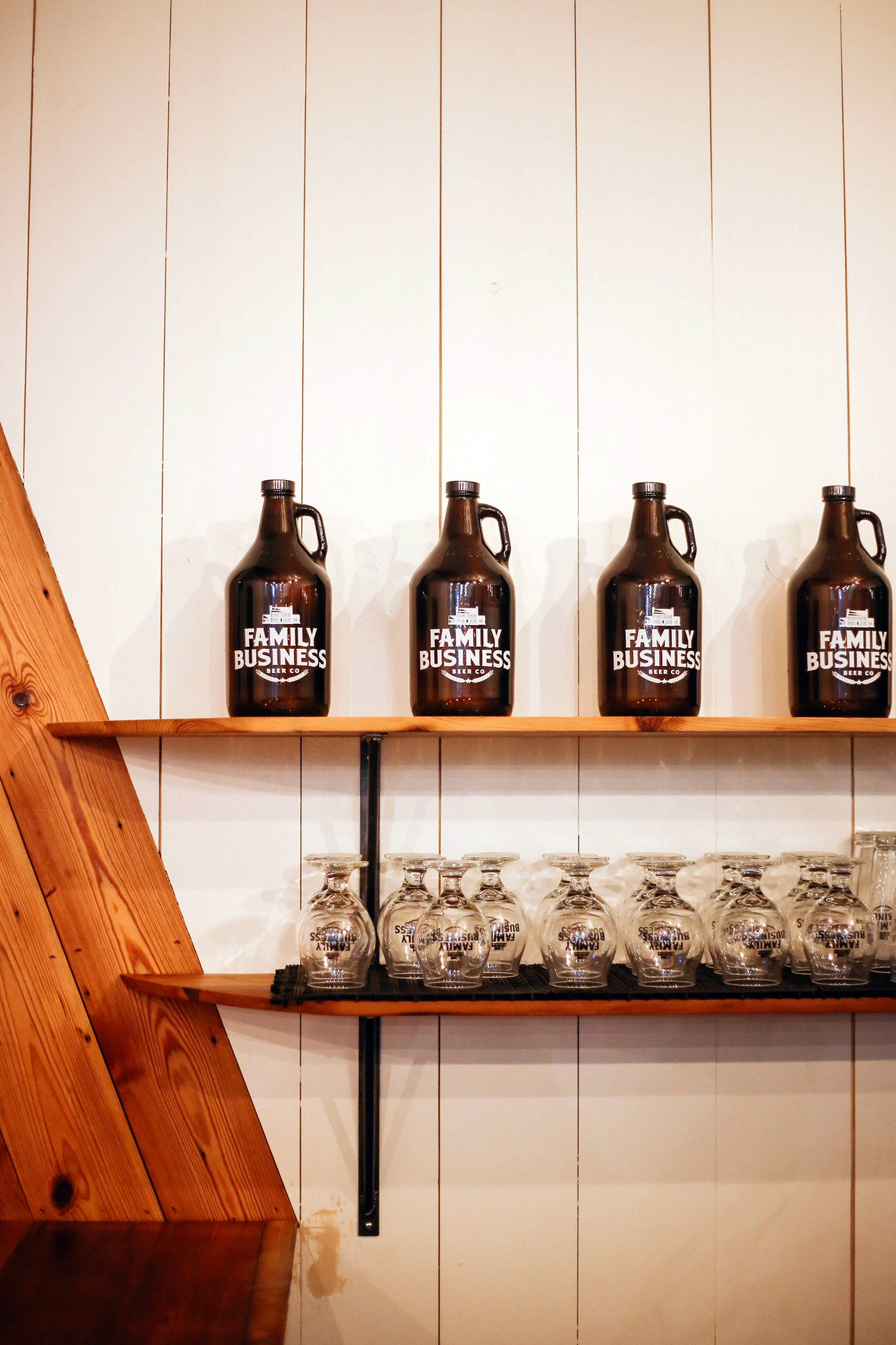 glasses and growlers on display at the Family Business Beer Company