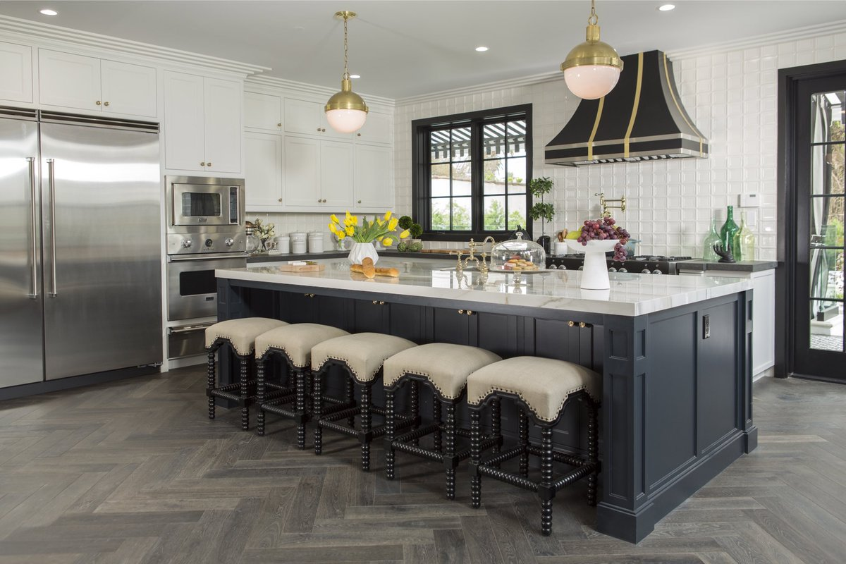 Black and white kitchen with brass. Shop Drew's Honeymoon House! {Kitchen & Dining Room} #PropertyBrothers