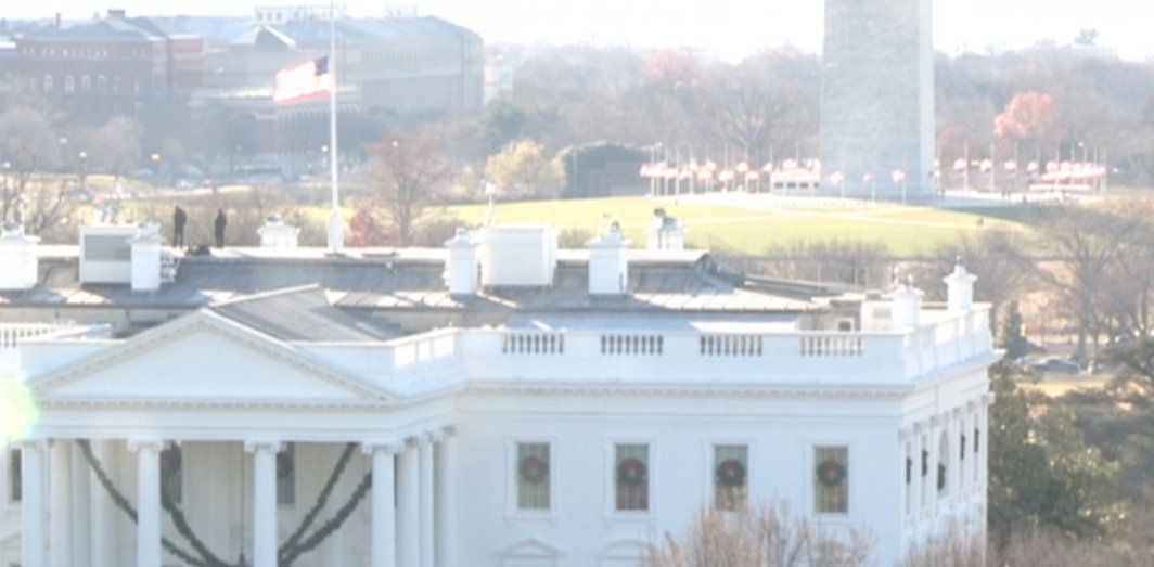 Flags atop WH and around Washington Monument at half-staff to mark Pearl Harbor Remembrance Day.