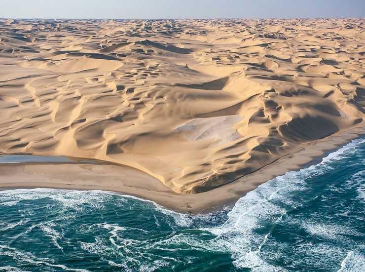 IMAGE: Desert meets the sea in Namibia https://t.co/zOZzW14vb9