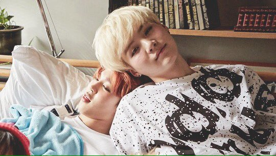 yoonmin leaning against each other https...
