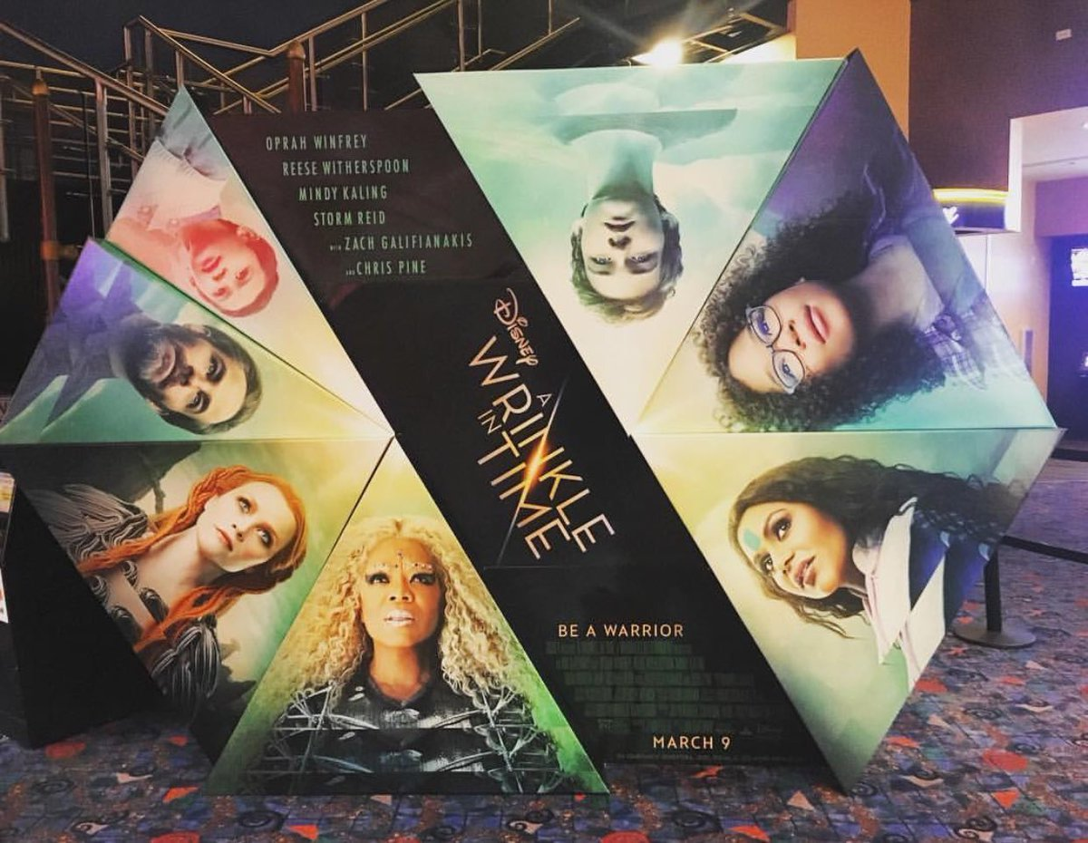 'A standee of the upcoming Disney epic adventure @WrinkleinTime.' from the web at 'https://pbs.twimg.com/media/DQzL2HRVwAAG2mz.jpg'