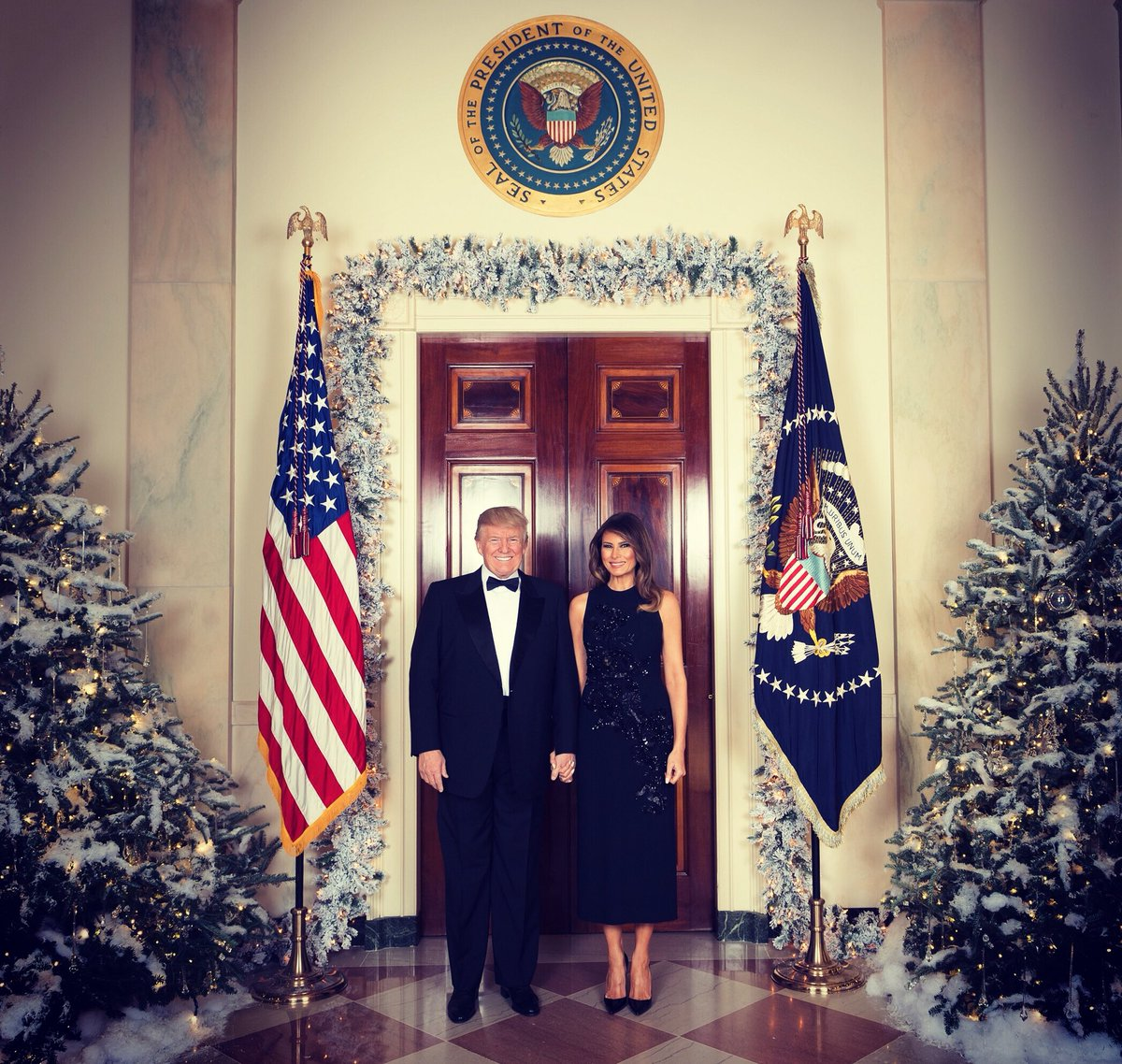 Merry Christmas from President Donald J. Trump and First Lady Melania Trump. @POTUS & @FLOTUS  are seen Tuesday, December 5, in their official 2017 Christmas portrait, in the Cross Hall of the White House in Washington, D.C. (Official White House Photo by Andrea Hanks)
