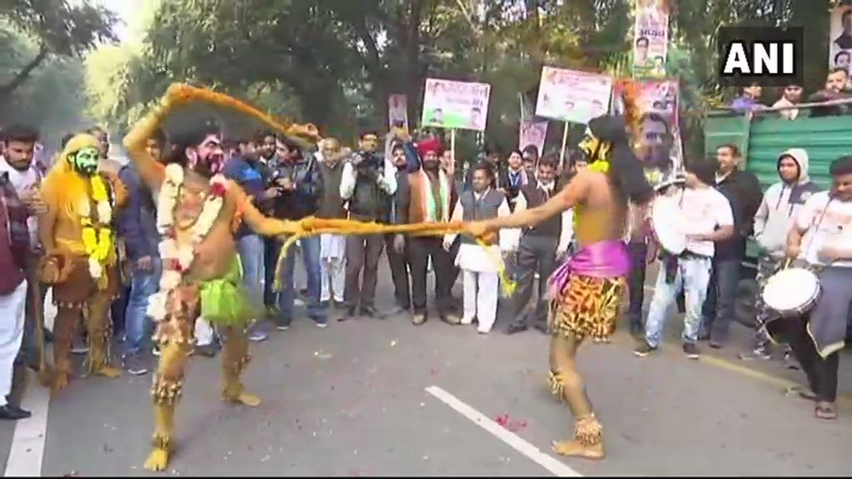 Delhi: Artists performing outside Congress Headquarters, ahead of Rahul Gandhi's takeover as Congress President.