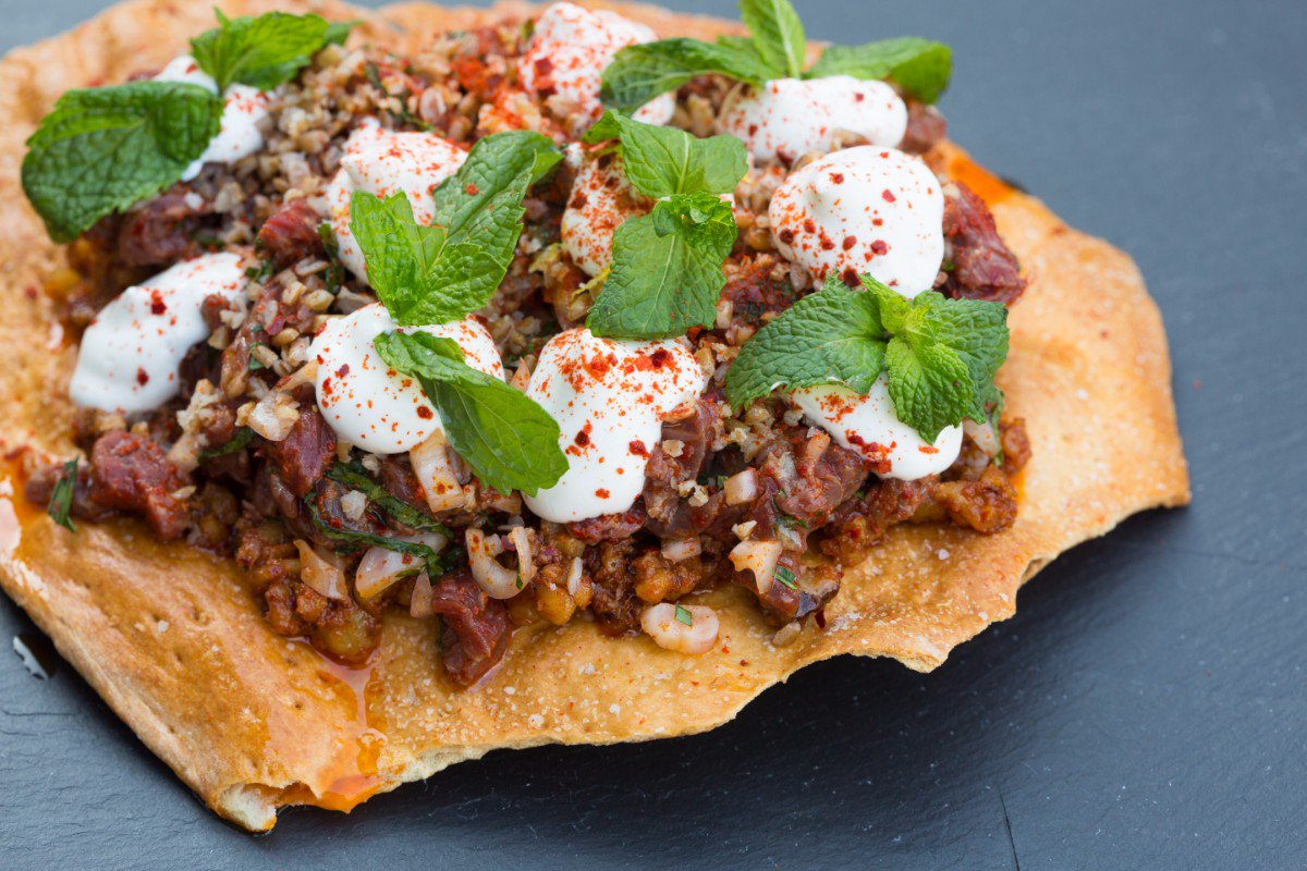 Inspired by his wife of Lebanese, Iraqi and Palestinian heritage, @chef_timothy Hollingsworth of @otiumla infuses this beef tartare dish with the flavors of the Middle East using lavash cracker, aleppo, mint, and bulgur. https://t.co/lR4Vr19MFx #MRE