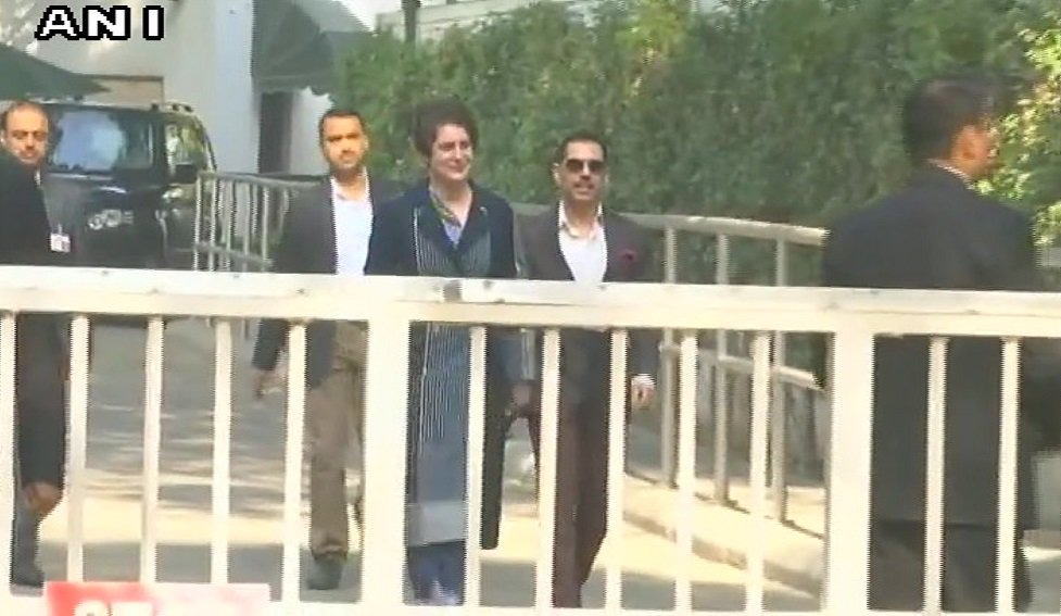 Priyanka Gandhi Vadra and her husband Robert Vadra reach Congress HQ at Akbar Road ahead of Rahul Gandhi taking charge as party President   Picture Credits: ANI   https://t.co/HyxALxAcr6