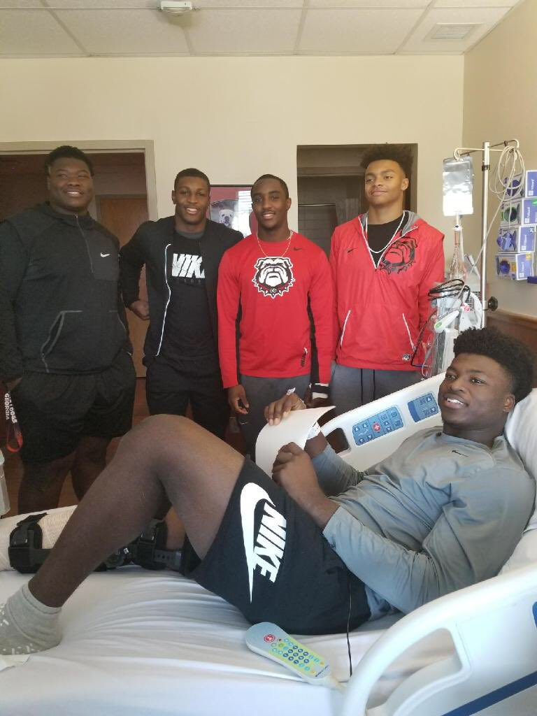 Trey Hill, Channing Tindall, Kearis Jackson, and Justin Fields drop by to show support and put a smile on the face of 2018 DE/OLB commit Azeez Ojulari after his surgery. (Photo from Azeez Ojulari / Twitter)