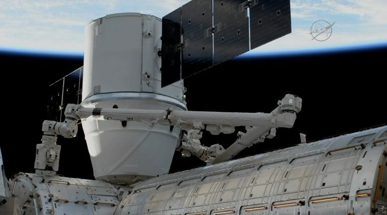 Dragon now installed at the @Space_Station. Crew will open the hatch later today.