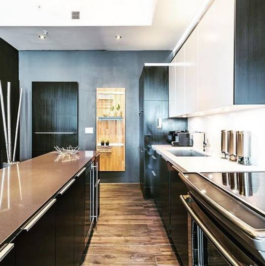At The #Meridian South Beach Lofts A Gorgeous #Poggenpohl #kitchen In  Shades Of Black Combined With Details In Stainless Steel And Wood Creates  The Perfect ...