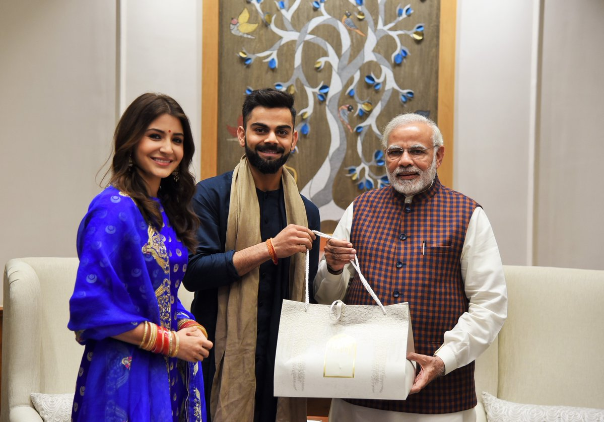 Virat Kohli and Anushka Sharma met PM Modi this evening. Prime Minister congratulated them on their wedding: PMO
