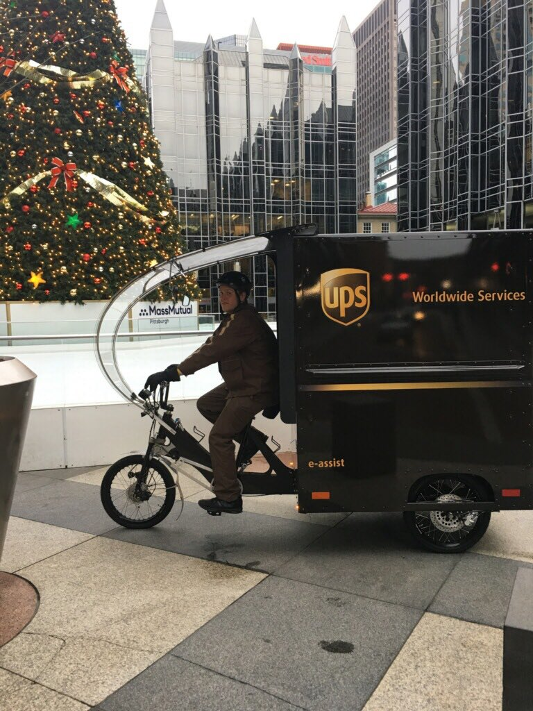 """Merry Christmas on Peak Day from Downtown Pittsburgh in Market Square! Our Cyclist Andrew is making his rounds with our new e-Bike """"Ebi"""". Ebi is very popular among our valued Customers and Pedestrians alike! #greencompany                                 # sustainablesolutions <br>http://pic.twitter.com/3MnTrcyCsm"""