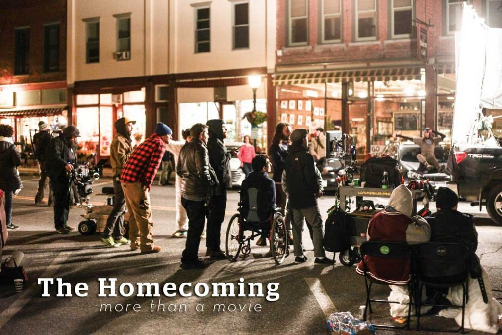 behind the scenes of a street shot for the film the homecoming several  people on set 39789555d