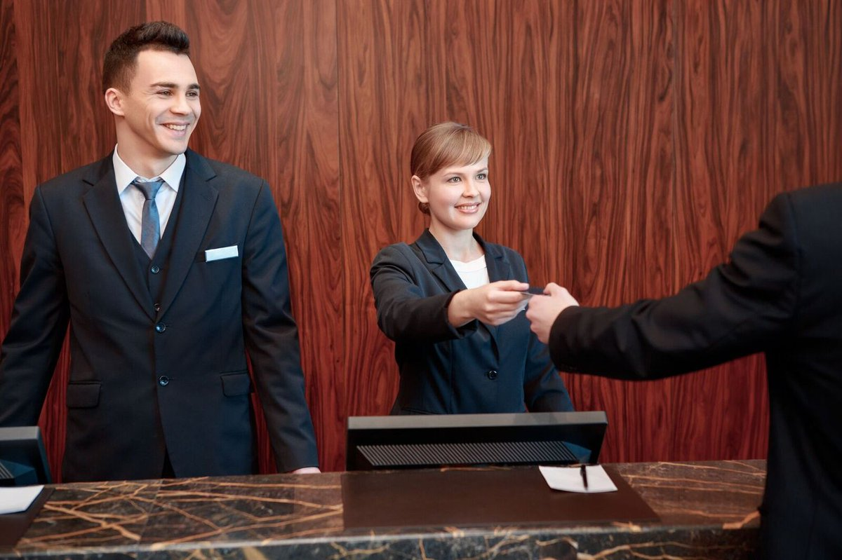 Image result for receptionist male and female
