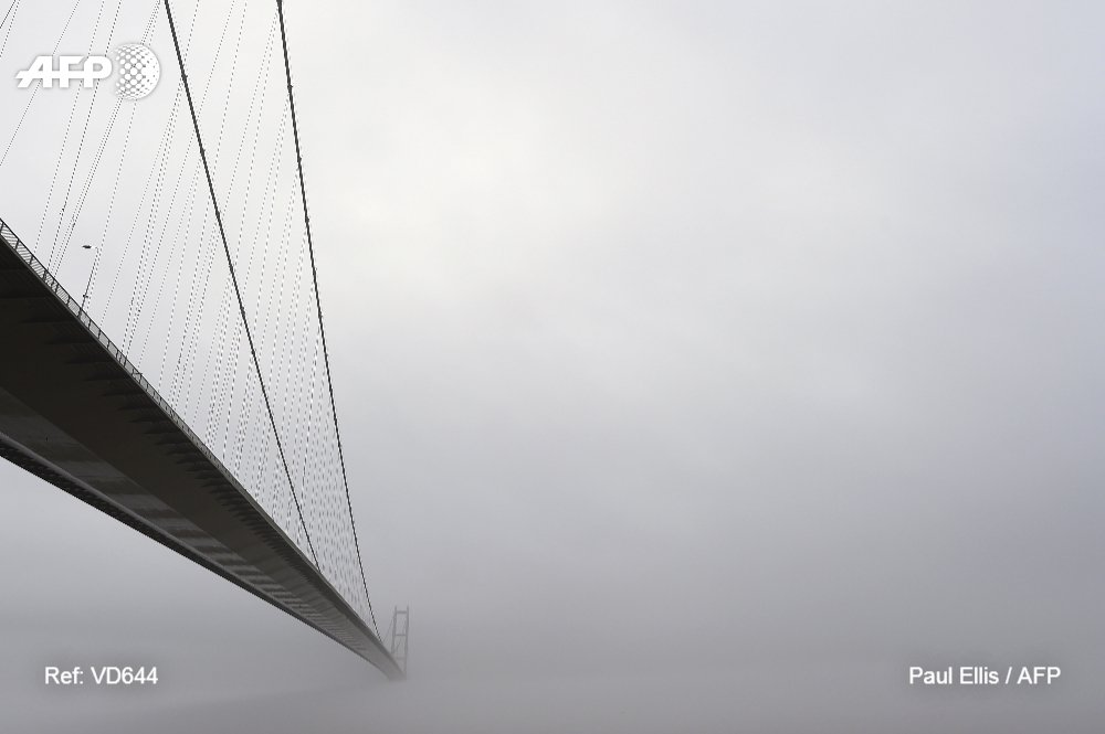 Into the mist: the Humber bridge near Hull in northeast England is enveloped in a low-hanging cloud