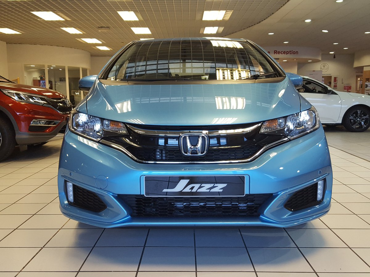 5ac7e509d A fresh new look including new alloy wheels and available in fantastic  Skyride Blue Metallic. Order your  Jazz today at North Wales Honda
