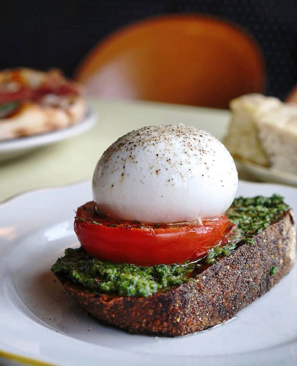 Your brunch options just got better, so don't drop the ball and head to @nizzanyc for something toasty! — Featuring a big ball of burrata, tomato slice, generous spread of pesto on top of a crispy thick toast. Yum! — #palateconnect #nizzanyc #burrata  📷: @myphotosandeats