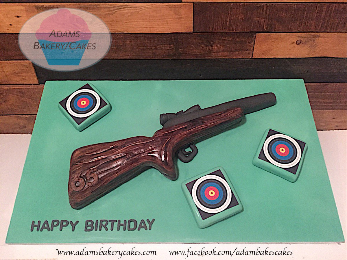 Rifle Shaped Target Cake Made To Order CakesAdams With Targets Also Being From Slices Of Sponge Sheffieldissuper Cakes Bespoke