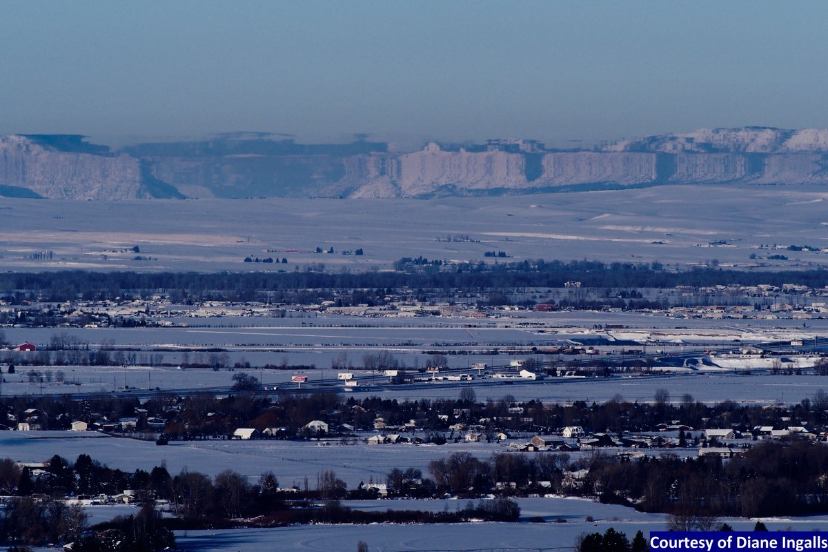 Interesting atmospheric refraction phenomena observed this morning across the Bozeman Valley. This is a mirage called a 'Fata Morgana', or 'looming'. This occurs due to a strong temp inversion of warmer air above much colder air creating a 'stretched' image of far away objects.