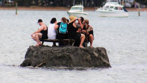 Image result for NZ revelers build sand island to defy alcohol ban, authorities admire their ingenuity