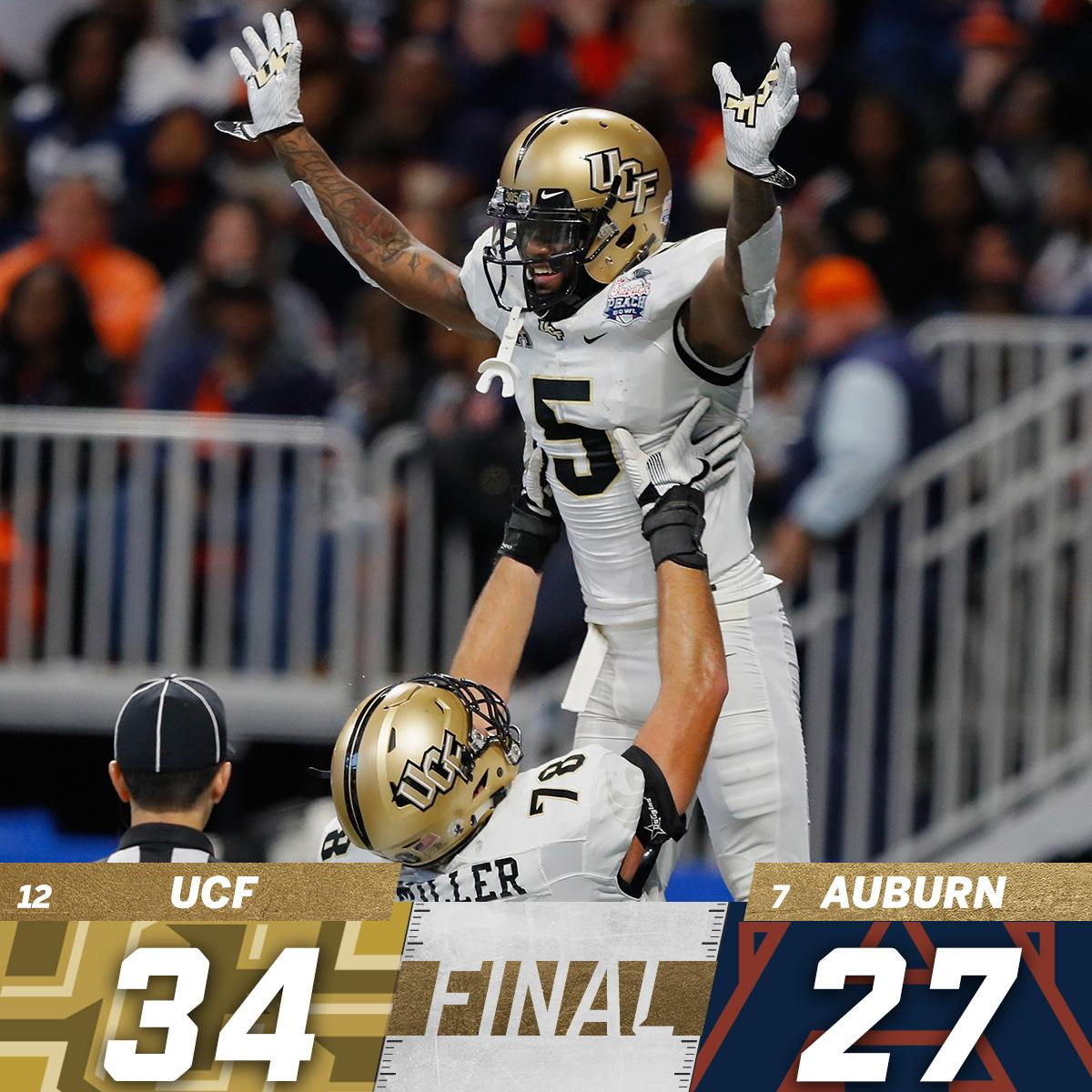 Perfection!  UCF completes a 13-0 season in Scott Frost's finale, taking down Auburn in the Chick-fil-A Peach Bowl.