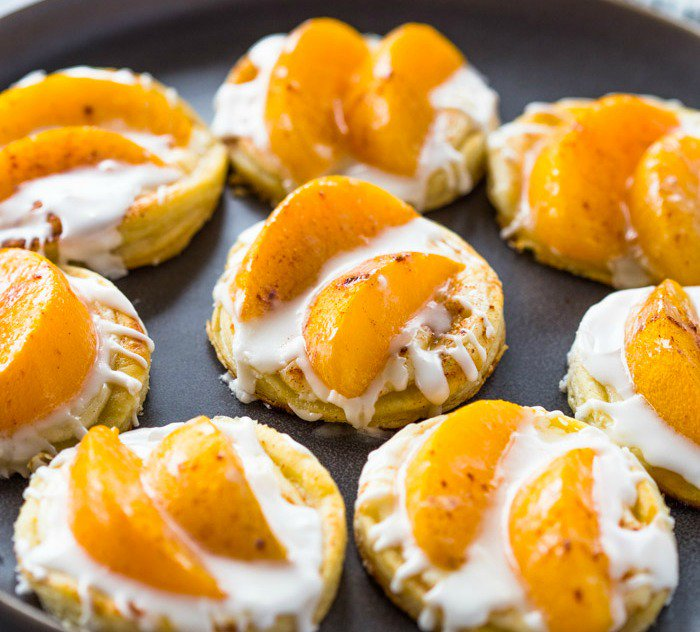 Peaches and cream pastries topped with a vanilla-flavored cream cheese filling and piled high with juicy @LibbysTable Peaches  #LibbysTable #ad