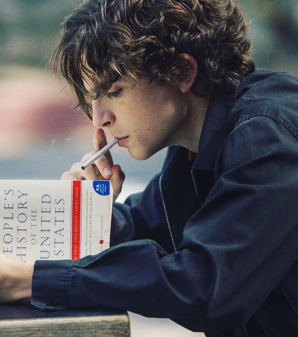 Timothée Chalamet smoking a cigarette (or weed)