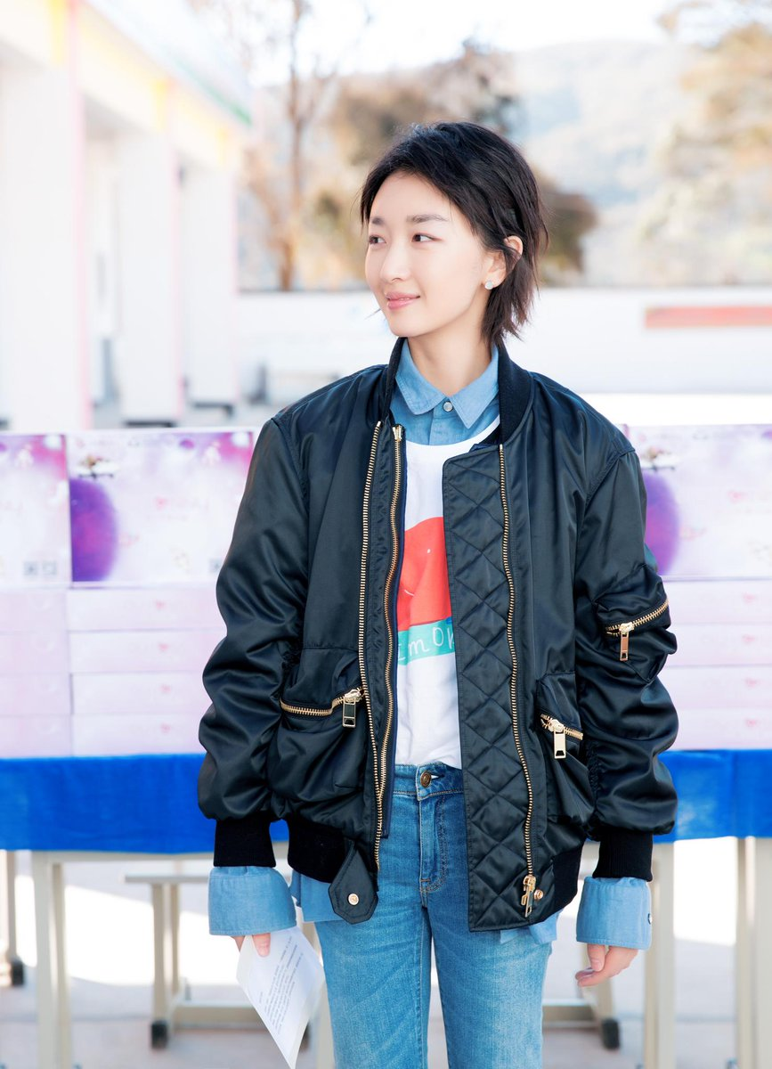 Zhou Dongyu wears a @Burberry bomber jacket and jeans in Yunnan