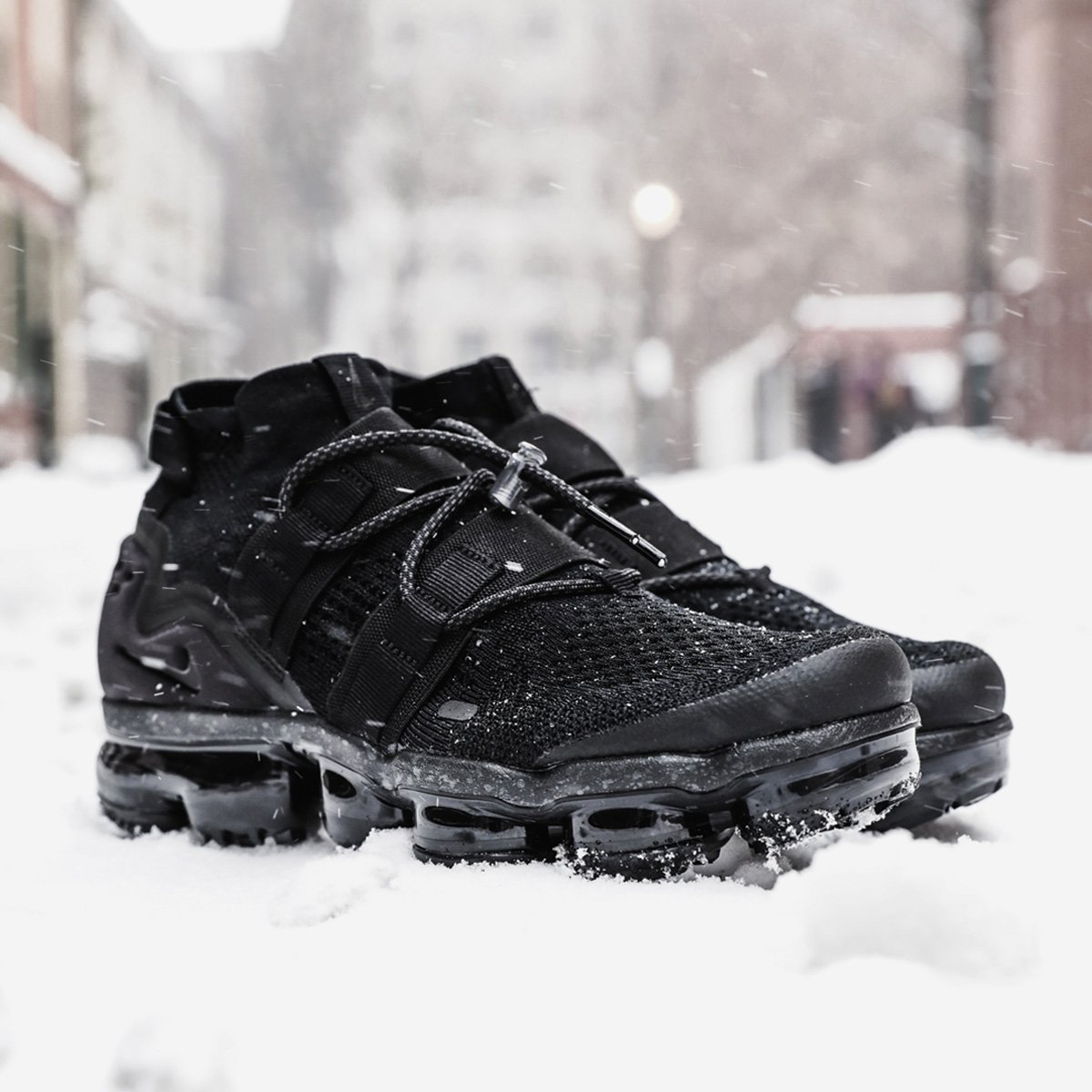 8f6439f8b8c Nike Air Vapormax Flyknit Utility  Maximum Black  is now available  in-store. This silhouette is a three-quarter-high mid cut with toggle  lacing system to ...
