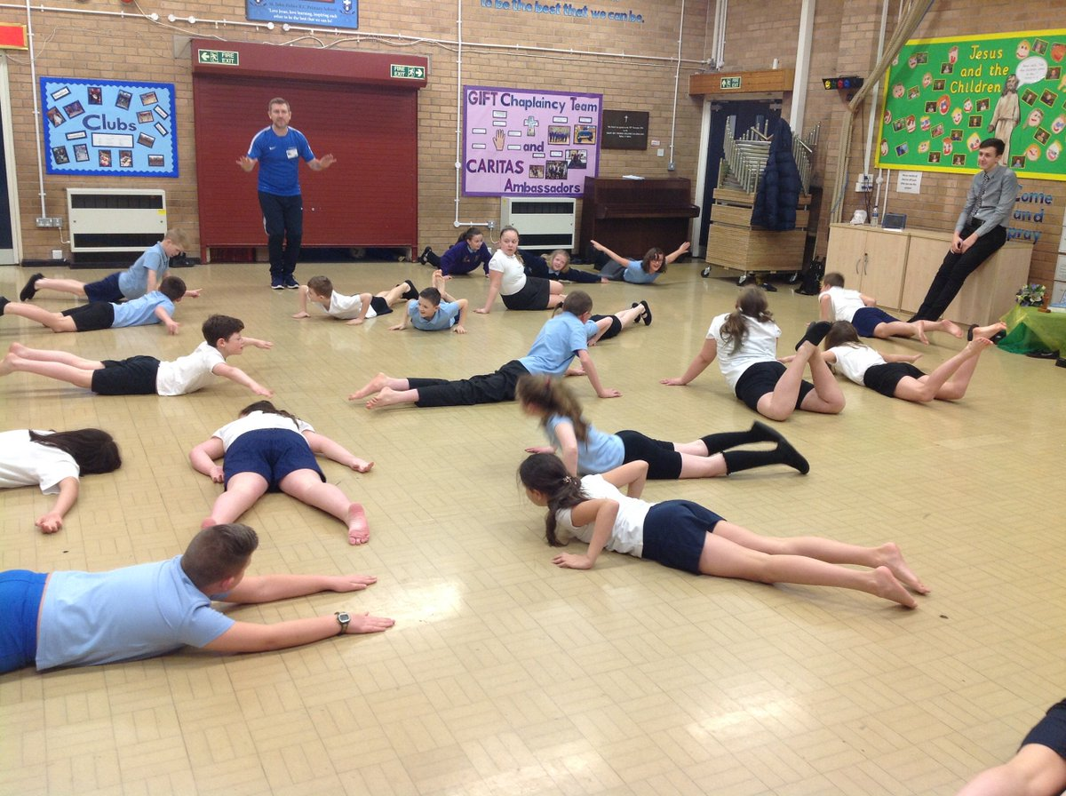 Y6 using warming-up techniques ready for the gymnastics lesson.