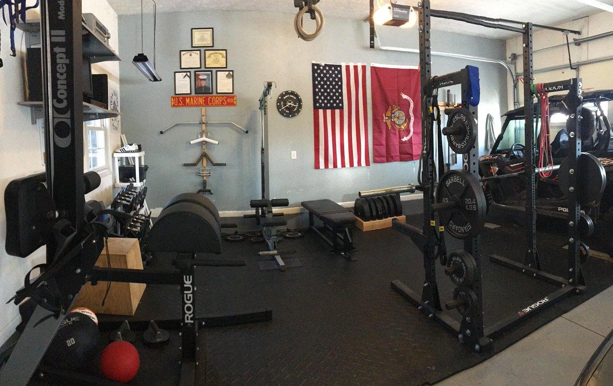 Gym using half of car garage homegym