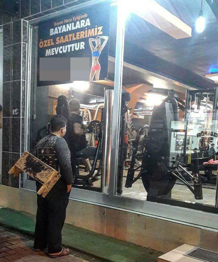 Turkish social media was heartbroken over the viral photo of a Syrian refugee shoeshine boy staring in from the outside of a southeast Turkey gym (left). So the gym gave the 12-year-old Muhammad Hussein a free lifetime membership. (right, DHA photo)