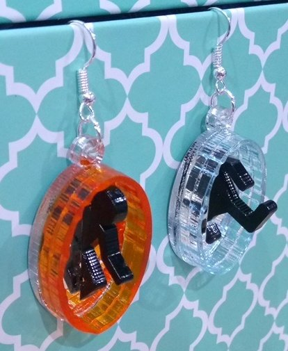 Portal earrings made from laser cut perspex and mirror.