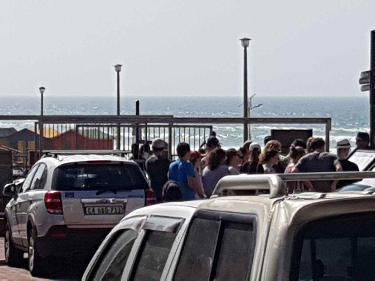 Crowds unable to cross the line. Surfers in wetsuits clambering over the fences. Open the gates please @CapeTownTrains