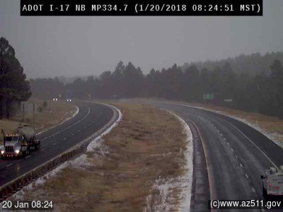 Snow is starting to fall around #Flagstaff. Here's our camera on I-17 about 6 miles south of town. #azwx