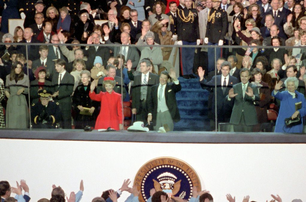 On This Day. 1981: Ronald Reagan waves as the Secret Service agent who would soon save his life - Jerry Parr - stands close behind