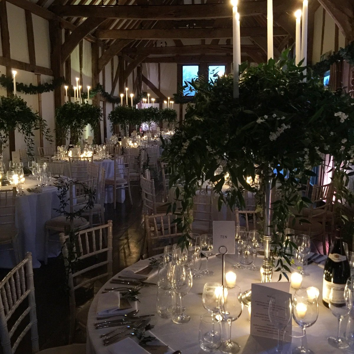 Don't you just love this romantic candle light for a #Christmas #wedding? #loseleypark @Loseleyevents @stressfreehire #thegorgeousflowercompany #barn