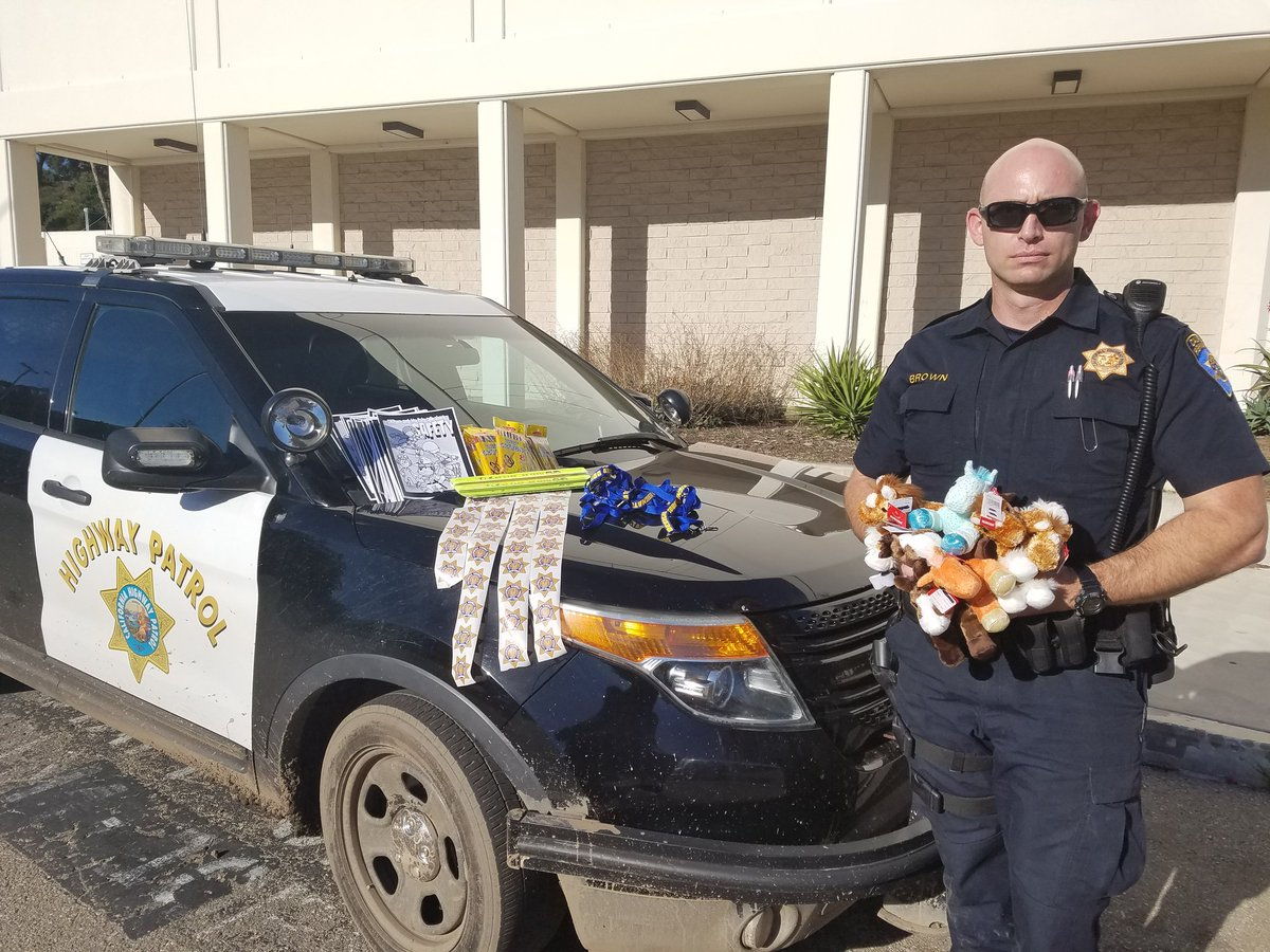 cross at santa barbara city college to hand out coloring books crayons safety bracelets stuffed animals stickers and lanyards to children affected