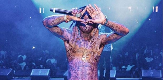 American Rapper Lil Wayne Denies Fatheri...
