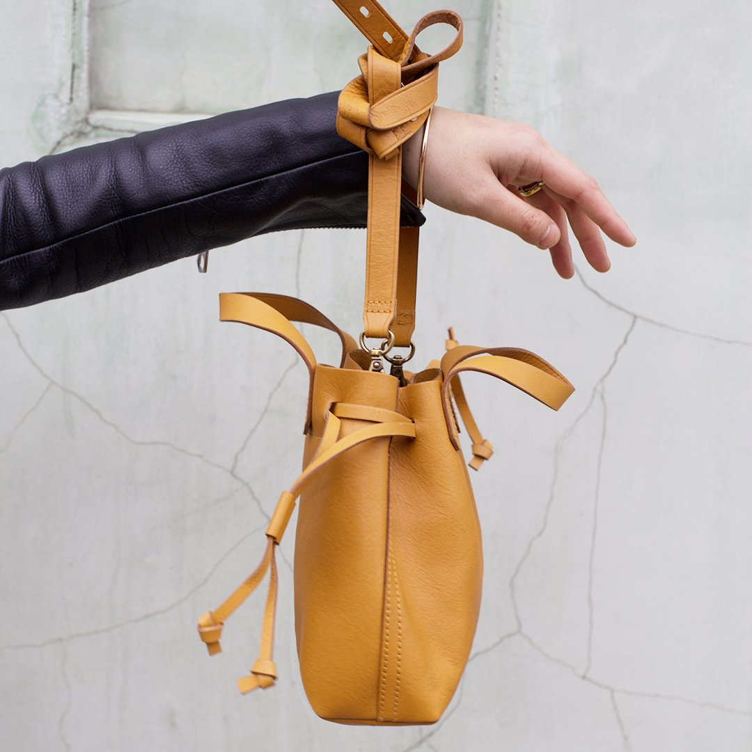b2046121e ... small drawstring transport crossbody (!). the newest member of our bag  fam is petite yet surprisingly roomy—and comes in 5 goes-with-everything  colors. ...